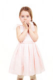 Shy little girl. In pink cute dress stock photography