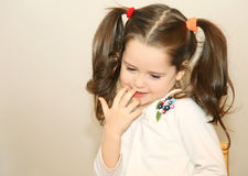 Shy little girl. Picture of shy little girl royalty free stock images