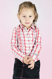 Shy little girl. Isolated on background royalty free stock image