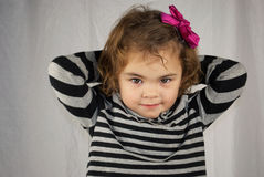 Shy Little Girl. Portrait of a young girl Stock Photo