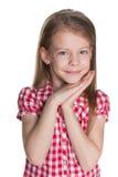 Shy little girl against the white Stock Photos
