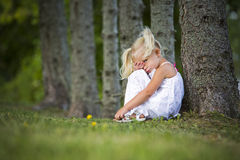 Shy little girl in the park Stock Images