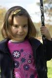 Shy little girl playing Stock Photo