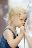 Shy little girl portrait Stock Images