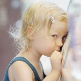 Shy little girl portrait. In a cafe stock photography