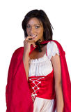 Shy little red riding hood biting her nail isolated on white Royalty Free Stock Photography