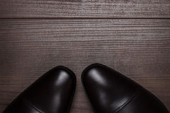 Shy man standing on the wooden floor Royalty Free Stock Photography