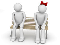 Shy man and woman on a bench Stock Photo