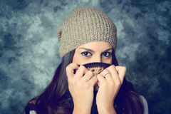 Shy mediterranean young woman with long brown hair Stock Photos