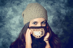 Shy mediterranean young woman with long brown hair Royalty Free Stock Photography