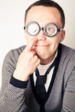 Shy nerd in funny glasses Stock Photo
