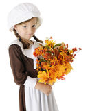Shy Pilgrim with Bouquet Royalty Free Stock Photography