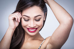 Shy Playful Beauty in Studio Portrait Stock Images