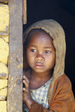 Shy and poor african girl with headkerchief Royalty Free Stock Image