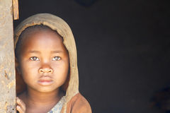 Shy and poor african girl with headkerchief Royalty Free Stock Photography