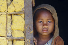 Shy and poor african girl with headkerchief Stock Photo