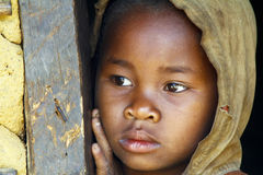 Shy and poor african girl with headkerchief Stock Image