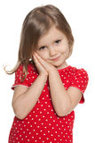 Shy preschool girl against the white Stock Photo