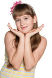 Shy preteen girl. Portrait of a shy preteen girl makes a hands gesture Royalty Free Stock Images