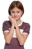 Shy preteen girl on the white. A shy preteen girl on the white background Royalty Free Stock Photography