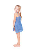 Shy pretty little girl in blue dress Royalty Free Stock Image