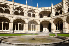 Shy rainbow in the Jeronimos inner courtyard. Internal courtyard of the Jeronimos (Hieronymites) Monastery, Lisbon Royalty Free Stock Images