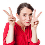 Shy 30s woman with two v victory signs agreeing Royalty Free Stock Photos