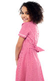Shy school girl in pink uniform Royalty Free Stock Image