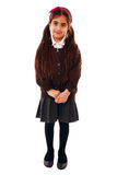 Shy schoolgirl. Schoolkid showing shyness isolated on white Stock Photo