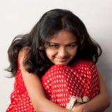 Shy smile of beautiful Indian girl. Isolated on white background royalty free stock photo
