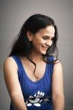 Shy smile of beautiful Indian girl Stock Photo