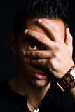 Shy spooky man hiding with hand on face. Portrait of shy man hiding with hand on face Royalty Free Stock Image