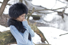Shy spring. Portrait of beautiful woman in a winter forest Stock Photo