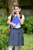 Shy Student Child. A young pretty asian girl child stock images