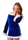 Shy teenage girl in suit of Santa Claus Royalty Free Stock Image