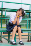 Shy Thai schoolgirl sitting on a stand Stock Photography