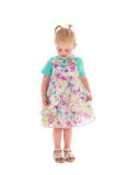 Shy toddler girl in summer dress Royalty Free Stock Image