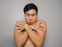 Shy topless man. Topless Asian man with funny act of shy and shocked Stock Photography