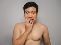 Shy topless man. Topless Asian man with funny act of shy and shocked Stock Photos