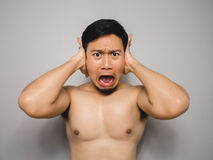 Shy topless man. Topless Asian man with funny act of shy and shocked Royalty Free Stock Photography