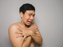 Shy topless man. Topless Asian man with funny act of shy and shocked Royalty Free Stock Photo