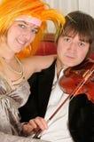 Shy violine player Royalty Free Stock Photos
