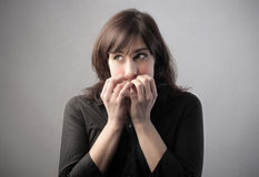 Shy woman Stock Photography