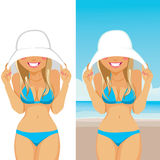 Shy Woman With Hat. Beautiful young shy blonde woman in bikini hiding her face with big white hat on the beach Stock Images
