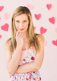 Shy Woman With Heart Shaped Papers Against Colored Background Royalty Free Stock Image