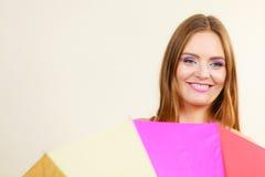 Shy woman hiding behind colorful umbrella Royalty Free Stock Photos