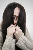 Shy. Woman hiding face behind hair Royalty Free Stock Images