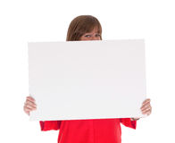 Shy woman holding a big blank card Stock Images