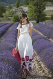 Shy woman in lavender field Stock Image