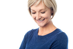 Shy woman looking downwards Stock Photo